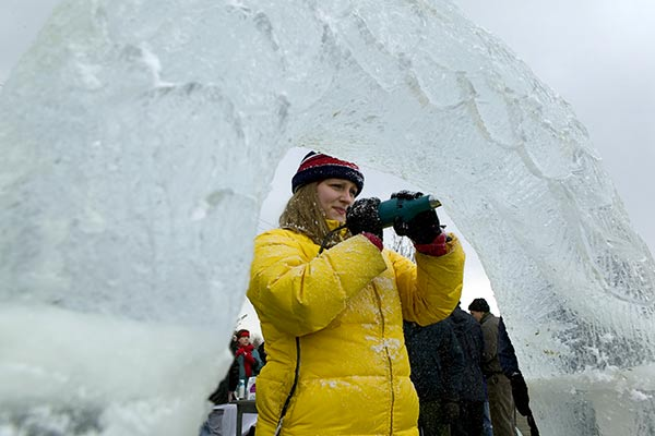 A woman carves ice at the Ice Carving Festival.