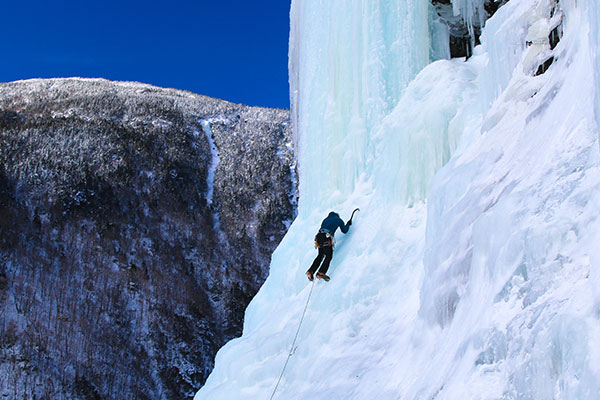A person ice climbs Mount Mansfield.