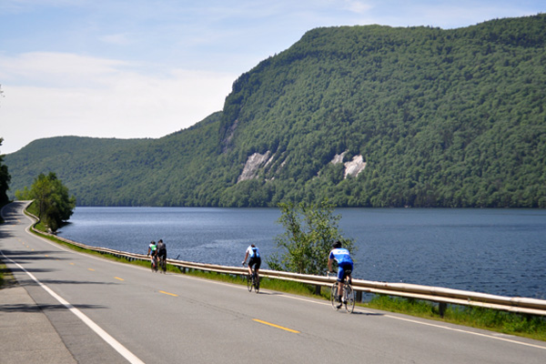 Cycling along Lake Willoughby in Westmore, Vermont. Photo Credit: Tour de Kingdom by Kingdom Games.