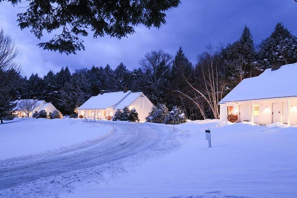 Snowy Inn at dusk with welcoming lights