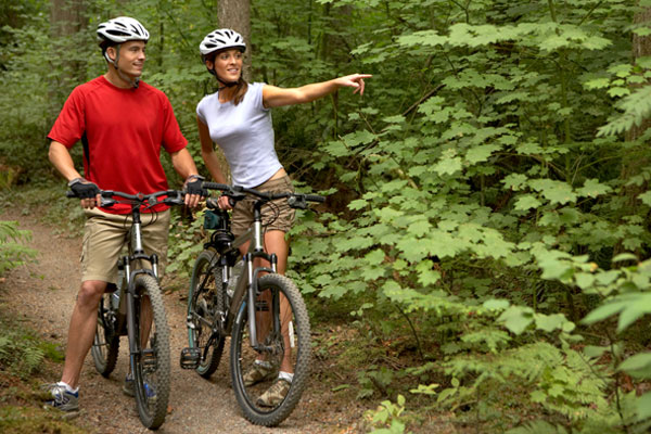 A couple enjoys a Vermont bike ride before enjoying a Vermont brew.