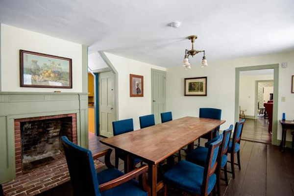 A long rectangle dining table and chairs are the focal point of a welcoming dining room.