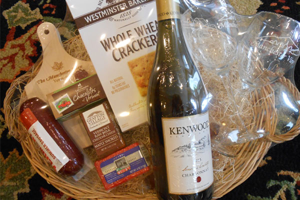 Welcome basket with wine, cheese and crackers.