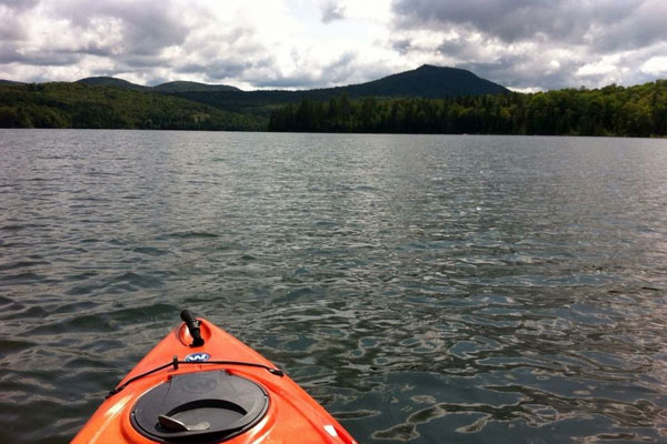 View of lake and mountain from a kayaker's perspective