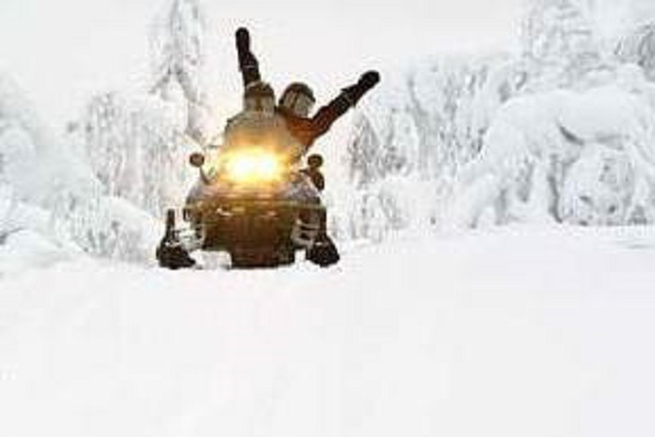 Double riders on snowmobile