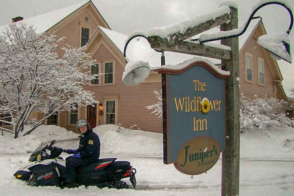 Wildflower Inn Sign with snowmobiler