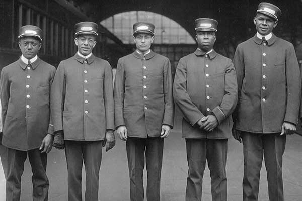 A line of porters in uniform.