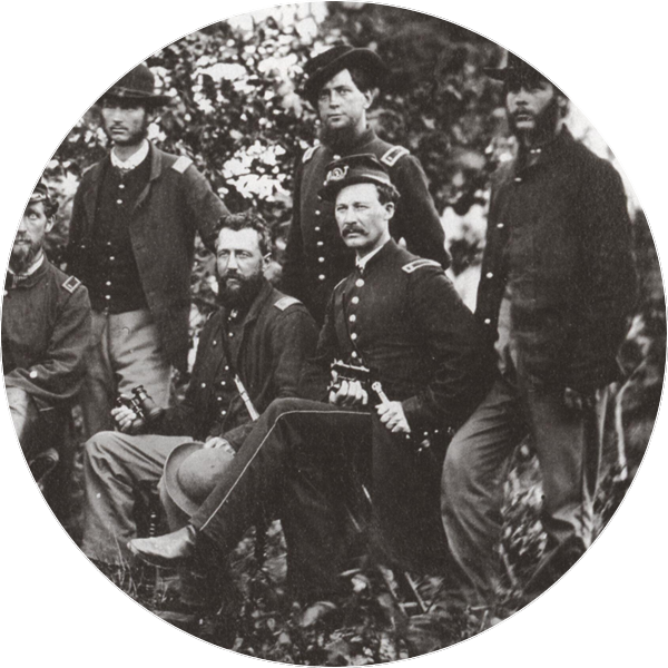historic black and white photograph of Civil War soldiers posing for a photo in clean uniforms
