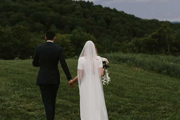 Vermont wedding bride and groom within Vermont mountains