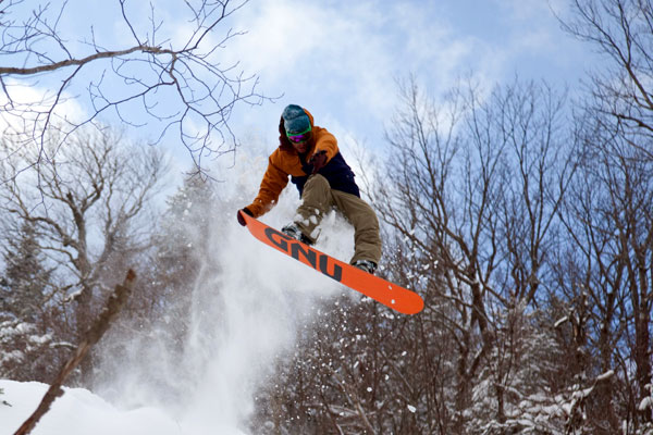 Snowboarder Launching Tail-grab