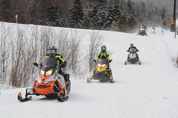 Group of Snowmobiles along the VAST Trail