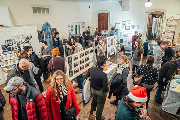 Shoppers browse the products in a Winooski gallery.