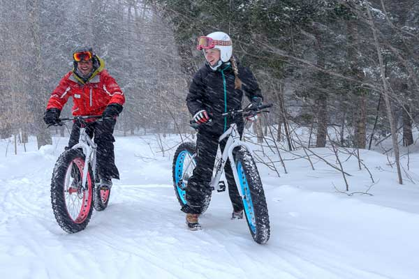 Fat bikers smile as they ride the trails near Stratton Mountain, South Londonderry, VT.