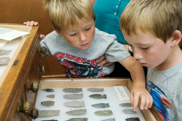 kids observing arrowheads at a vermont state historic site