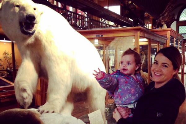 A mother and daughter stop at the polar bear exhibit at Fairbanks museum.