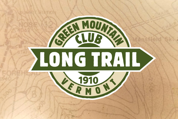 Green Mountain Club logo over map contour lines.