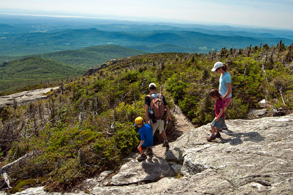A family descends off Mount Mansfield.